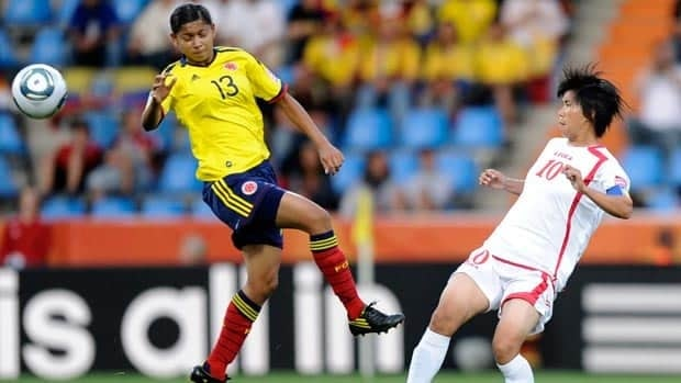 Colombia's Yulieht Dominguez, left, and North Korea's Jo Yun Mi challenge for the ball during Group C action Wednesday in Bochum, Germany.