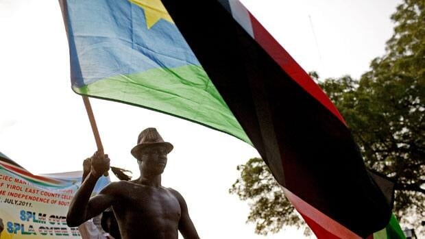A Southern Sudanese man carries a national flag during a pre-independence celebration in Juba, the capital city, on Friday.