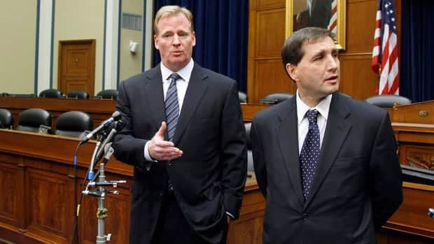 NFL commissioner Roger Goodell, left, accompanied by NFL lead counsel Jeff Pash, speaks with reporters on Capitol Hill in Washington on Friday after meeting with two members of Congress to discuss HGH testing for NFL players.