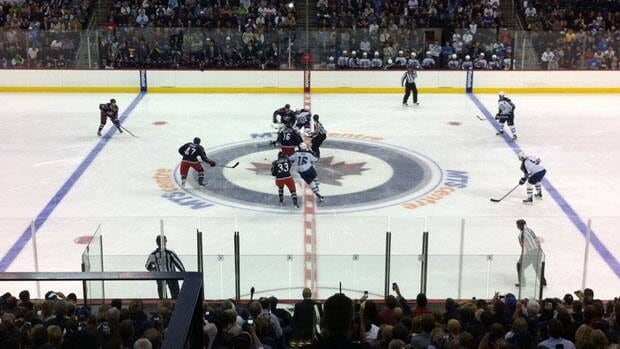 Winnipeg Jets fans pack the MTS Centre as the team faced off in its first pre-season home game Tuesday evening.