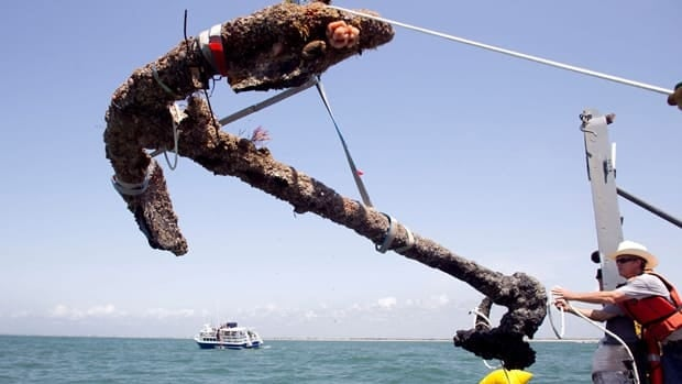 An anchor from what is believed to be the wreck of the pirate Blackbeard's flagship, the Queen Anne's Revenge, is recovered from the ocean where it has been since 1718.