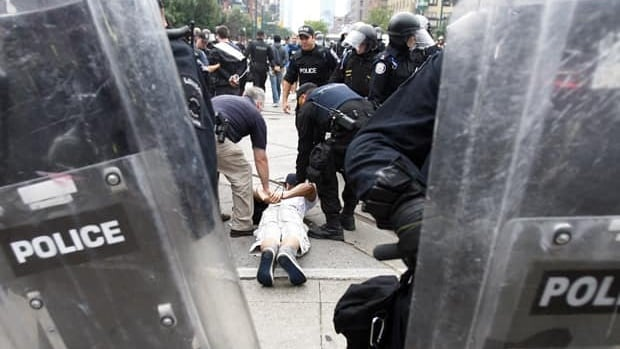 Police arrest a protester during a G20 march in downtown Toronto on June 27.