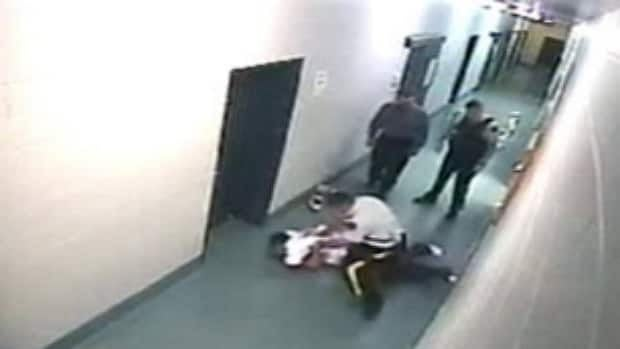 RCMP surveillance video showed Const. Desmond Sandboe beating Andrew Clyburn at the Lac La Biche, Alta., detachment on Sept. 13, 2009.