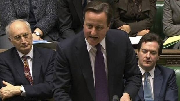 Britain's Prime Minister David Cameron speaks in the House of Commons on Monday as he defends his decision to veto a European plan meant to combat the financial crisis swamping the region.
