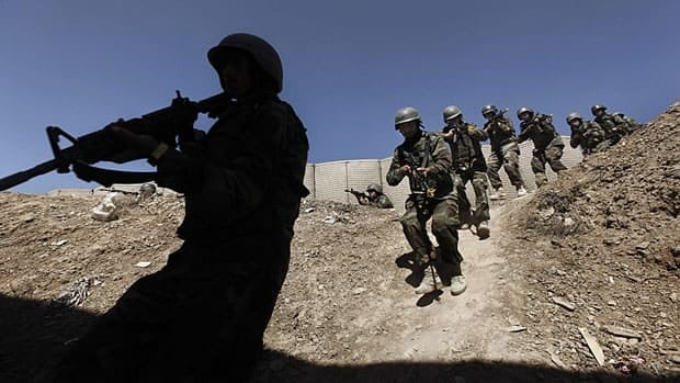 By November, Canadian military trainers will take on a central role in training the Afghan National Army, seen here during a training session at Camp Morehead on the outskirts of Kabul in March.