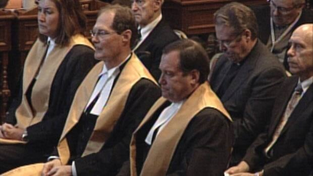 New Brunswick Court of Appeal justices Kathleen Quigg (left), Richard Bell (centre_ and Bradley Green (right) listen to the throne speech on Wednesday.