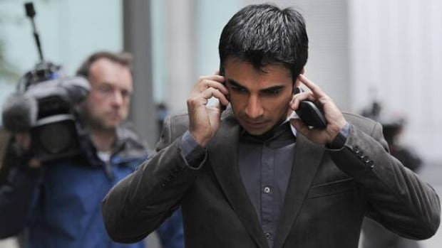 Former Pakistan captain Salman Butt makes a phone call outside London's Southwark Crown Court on Wednesday.