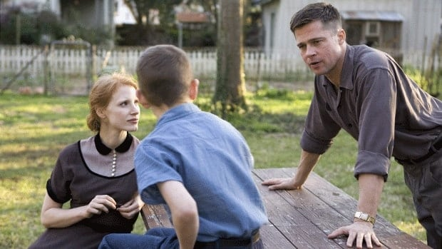 Jessica Chastain, Tye Sheridan, and Brad Pitt are shown in a scene from The Tree of Life.
