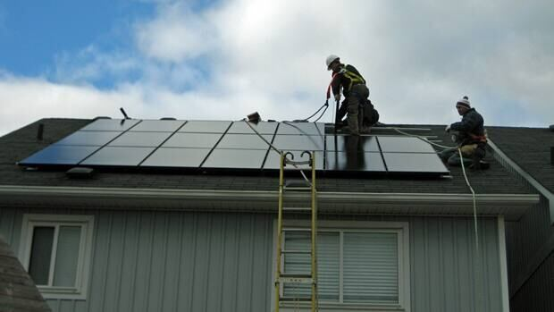 The installation of solar panels on the home of Scott and Laurie Bennett, who were some of the first to take advantage of Ontario's microFIT program. The intiative offers a twenty-year purchasing agreement designed to get homeowners and businesses interested in microgeneration.
