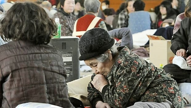 An elderly woman takes a rest at an evacuation center in Kamaishi, Iwate prefecture, two days after a powerful earthquake and tsunami hit the the country's northeastern coast. International aid agencies have opened lines to appeal for donations supporting relief efforts.