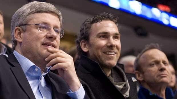 Prime Minister Stephen Harper, left, took in a game in Vancouver earlier this season with Canucks great Trevor Linden.