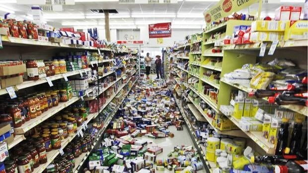 Debris covers the aisles at a food store in Mineral, Va., on Tuesday after a magnitude 5.8 earthquake hit the area.