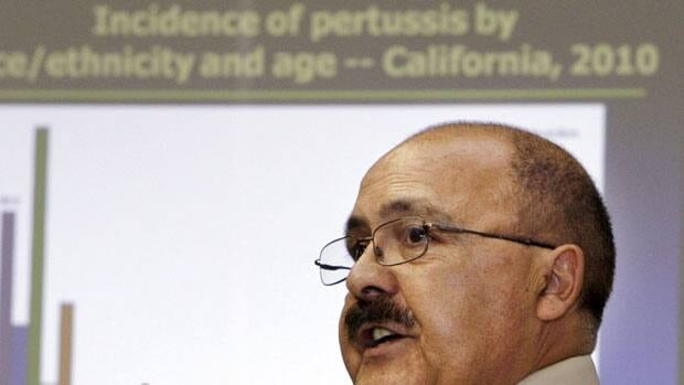 Dr. Juan Ruiz, of the California Department of Public Health, speaks at a news conference by the Centers for Disease Control and Prevention in July, 2010  to publicize a sharp increase in the number of pertussis, or whooping cough, cases reported in California.