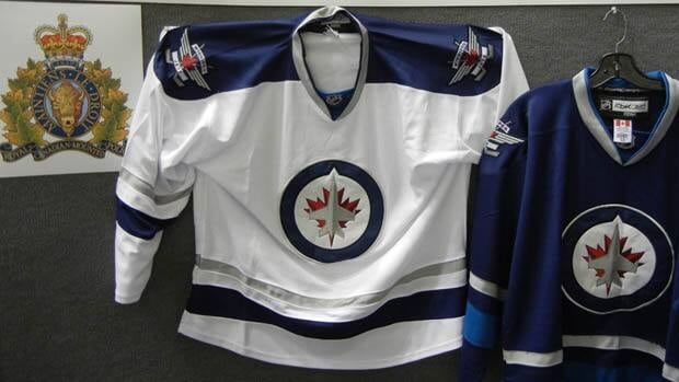RCMP and Canada Border Services agents seized these bogus Winnipeg Jets jerseys at the border Aug 21.