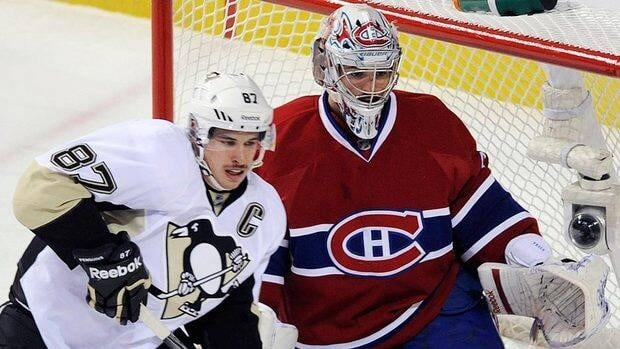 Penguins' Sidney Crosby, left, moves in on Canadiens' goaltender Carey Price during Saturday night's game at the Bell Centre in Montreal.