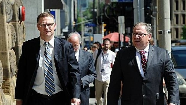 Nova Scotia Premier Darrell Dexter, right, arrives for a meeting with Prime Minister Stephen Harper in Ottawa on June 20.
