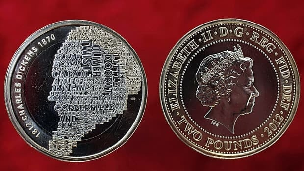Britain's Royal Mint has unveiled a £2 sterling coin with the Queen's head, right, and the reverse with the image of Charles Dickens, made up from some of the titles of his most famous novels.