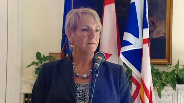 Kathy Dunderdale speaks with reporters at Government House in St. John's on Tuesday.