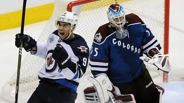 Winnipeg Jets left wing Evander Kane celebrates a goal against Colorado Avalanche goalie Jean-Sebastien Giguere in the second period on Tuesday.