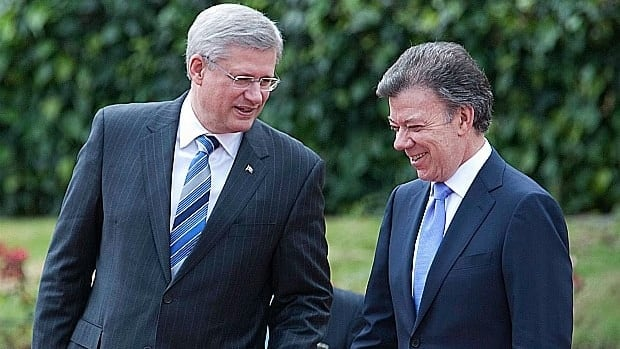 Prime Minister Stephen Harper speaks with Colombian President Juan Manuel Santos during a photo call at the presidential palace in Bogota on Wednesday.