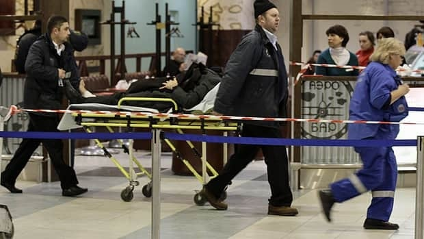 A wounded blast victim is moved on a stretcher at Domodedovo airport in Moscow on Jan. 24, 2011.  A suicide bomber set off an explosion that ripped through the Russian capital's busiest airport, killing at least 36 people.