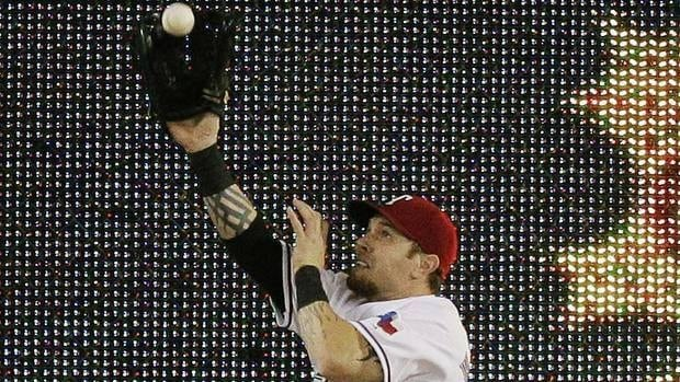 The Rangers' Josh Hamilton is a big threat at the plate, and not too shabby in the field, either, on this catch against the Tigers' Ryan Raburn in Game 6 of the AL Championship Series.