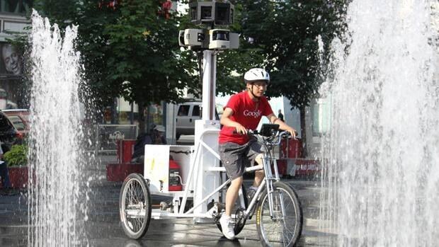 Jonathan Chang, 27, rides the Google Street View trike around Yonge-Dundas Square in Toronto.