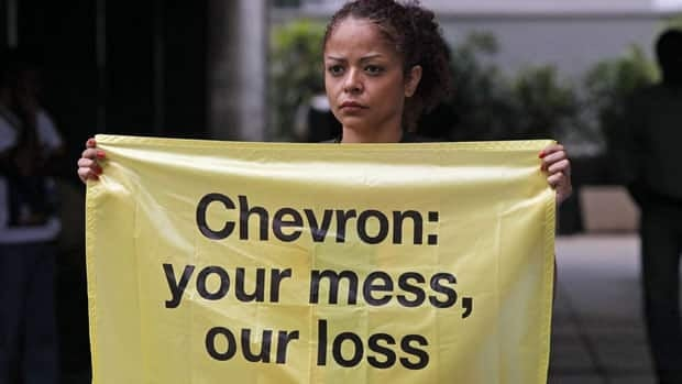 A Greenpeace activist protests an oil spill in an offshore field operated by Chevron Corp, outside Chevron's offices in Rio de Janeiro, on Friday.