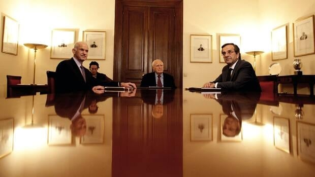 Greece's Prime Minister George Papandreou, President Karolos Papoulias and opposition leader Antonis Samaras sit at the Presidential Palace in Athens on Sunday.