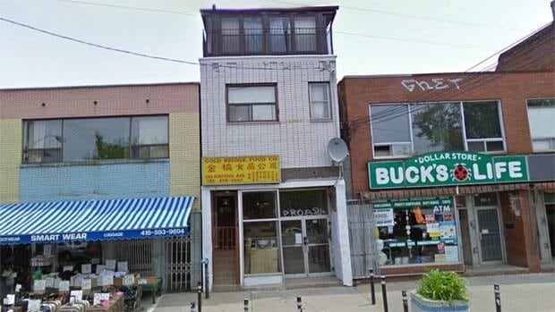 Police set up a command post at this building on Augusta Avenue in Kensington Market after a shooting nearby early Sunday morning. (Google Street View)