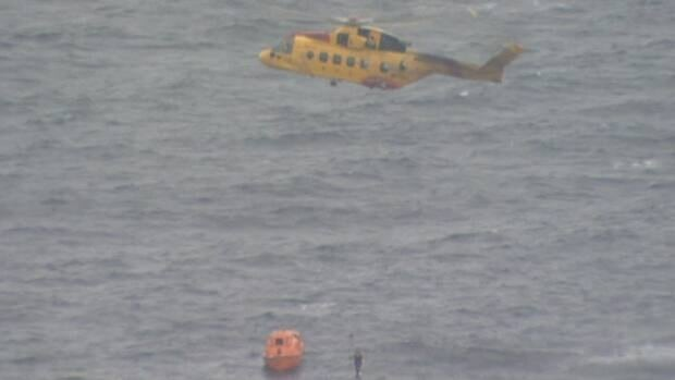A search and rescue helicopter hovers during a training exercise near St. John's in March.
