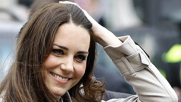Kate Middleton smiles as she arrives at city hall in Belfast, Northern Ireland, on Tuesday.