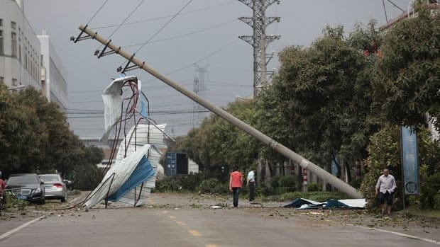 In this photo released by China's Xinhua News Agency, a pole which fell down in a wind storm sits in an industrial zone in Foshan City, China, on Sunday.