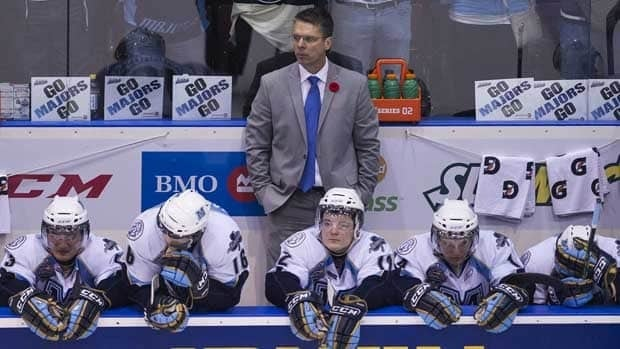 Majors coach Dave Cameron, top, and his players could only watch as Saint John celebrated its Memorial Cup victory.