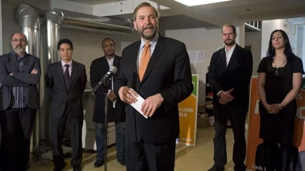 NDP deputy leader Thomas Mulcair speaks to reporters during a post-election news conference in Montreal, as newly-elected NDP MPs (left to right) Robert Aubin, Hoang Mai, Tyrone Benskin, Alexandre Boulerice and Marie-Claude Morin look on.