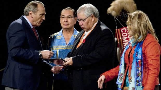 Aboriginal Affairs Minister John Duncan, left, takes part in a ceremony with Truth and Reconciliation Commission members Wilton Littlechild, Justice Murray Sinclair and Marie Wilson, at the panel's national event in Halifax on Oct. 29.