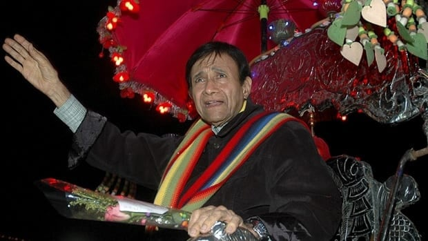 Bollywood director and actor Dev Anand waves to fans during a film premiere in 2005. He was known for his good looks, melodious voice and success in romantic leads during his lengthy career.