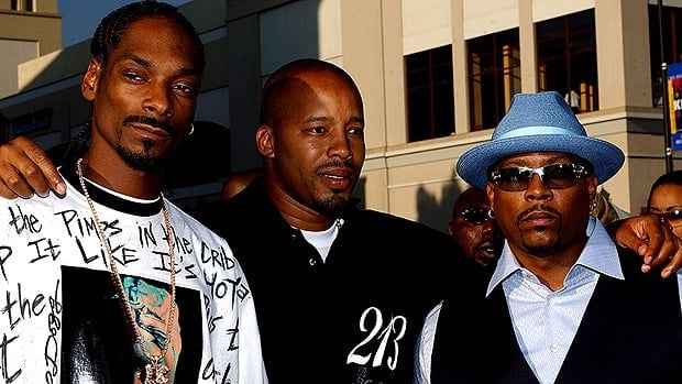 Singer Nate Dogg, right, is seen with friends and West Coast rappers Snoop Dogg, left, and Warren G. Nate Dogg, born Nathaniel Hale, has died.