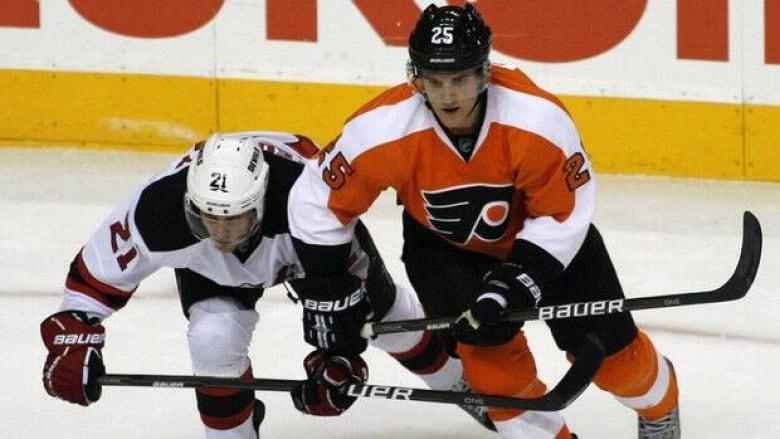New Jersey Devils  Mattias Tedenby (21) and Philadelphia Flyers  Matt Carle  (25) vie for puck control Thursday in Philadelphia. (H. Rumph  Jr. Associated ... 4ae7182f5