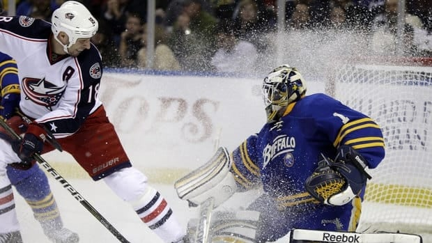 Buffalo Sabres goalie Jhonas Enroth, of Sweden, stops a shot by Columbus Blue Jackets' R. J. Umberger, left, during the second period Buffalo's win on Thursday night.