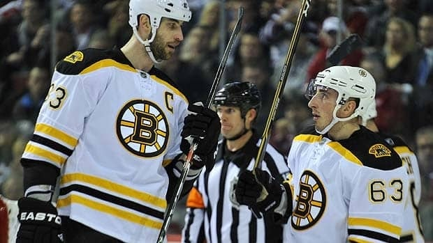 Perhaps Zdeno Chara, left, and Brad Marchand of the Bruins are discussing the team's poor performance on the power play during a break in Game 3 of their first-round series. Boston has yet to score in 11 chances with the man-advantage.