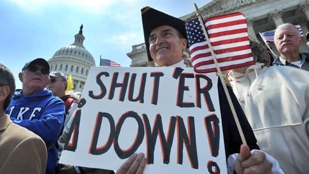 Protesters demonstrate in front of Capitol Hill in Washington, D.C., on Wednesday urging for government spending cuts.