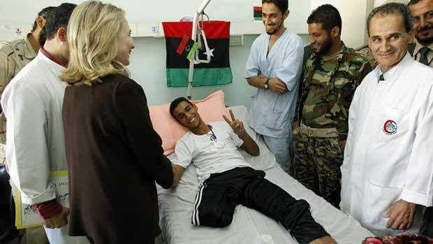 U.S. Secretary of State Hillary Clinton meets a wounded soldier at a Tripoli hospital during her visit to Libya on Tuesday.