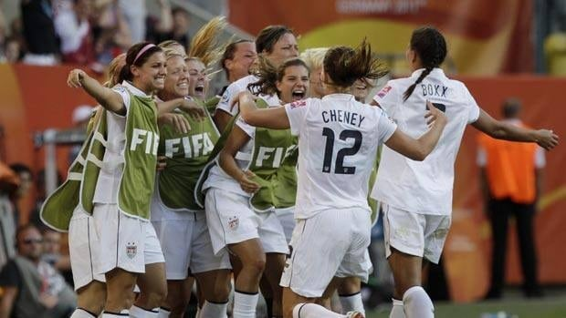 The U.S. team celebrates after Lauren Cheney scored the opening goal against North Korea.