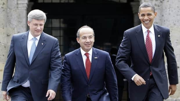 Canadian Prime Minister Stephen Harper, from left, was supposed to meet with Mexican President Felipe Calderon and U.S. President Barack Obama in Honolulu. Calderon has had to pull out.
