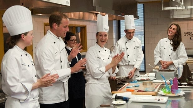 Prince William and the Duchess of Cambridge take part in a food preparation demonstration at the Quebec Institute for Hospitality and Tourism.