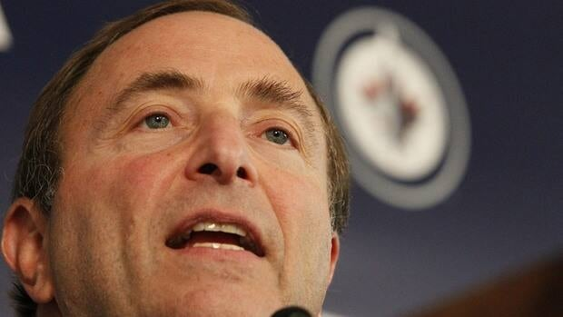 NHL commissioner Gary Bettman talks to media before the Winnipeg Jets inaugural game at the MTS Centre in Winnipeg, Sunday, Oct. 9, 2011.