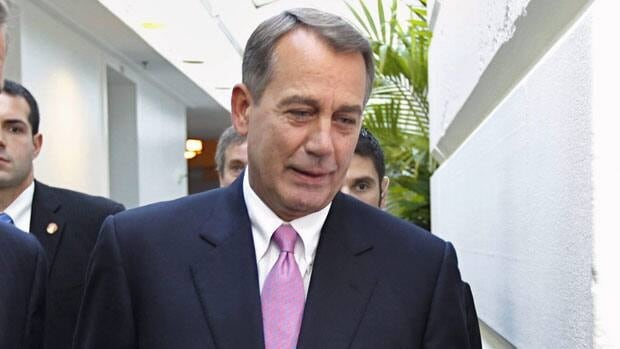 House Speaker John Boehner of Ohio walks to a closed-door Republican caucus on Wednesday to work on a bill designed to avoid a potential debt default.