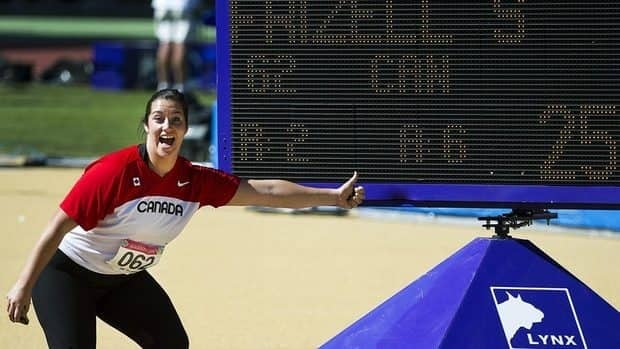 Canada's Sultana Frizell hams it up for the camera after winning silver in women's hammer throw at the 2011 Pan American Games in Guadalajara, Mexico on Monday.
