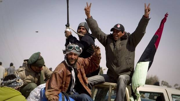 Libyan rebels celebrate Saturday after taking the city of Ajdabiya, south of Benghazi in eastern Libya.